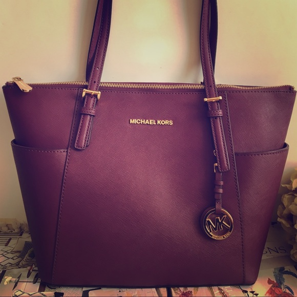 5a57cd6426d779 Michael Kors Burgundy tote bag. M_5a732b799a9455c483c26464